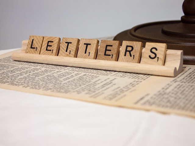 Scrabble letters that spells letters